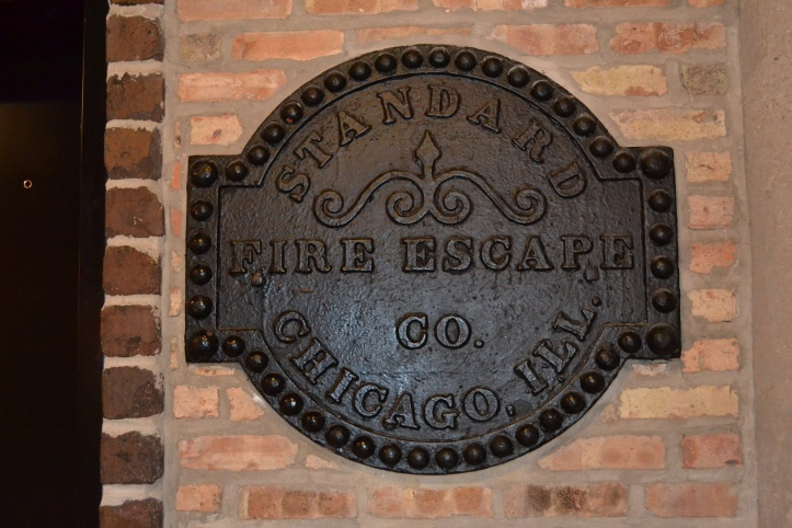 Old iron sign on the wall of the loft building