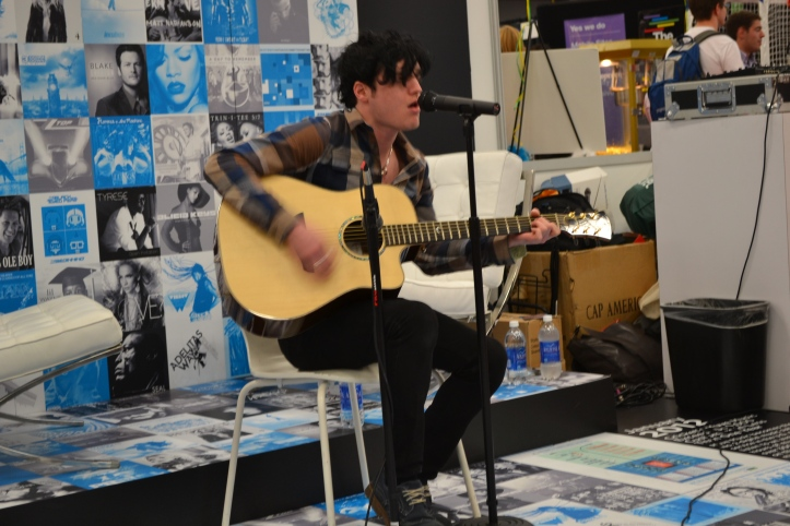 Lead singer of The Virginmarys performing an acoustic set at the Cricket booth (client) at SXSW
