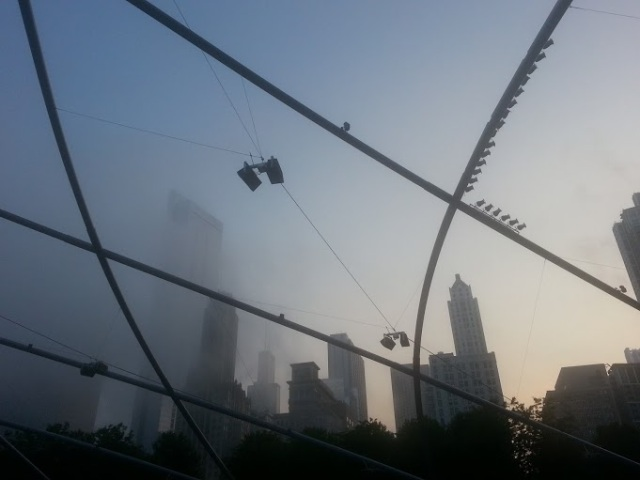 The fog slowly starts to cover Pritzker Pavilion
