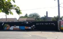 Sleep is the Cousin of Death mural by Hebru Brantley