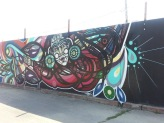 Mural by Del Real at Mega Mall in Logan Square