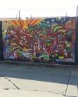Urban art mural by Fact