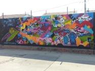 Brooks Golden urban art mural at Mega Mall in Logan Square