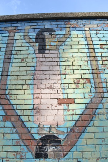 Zoomed-out view of Egyptian mural in Pilsen's Dvorak Park