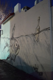 This piece lives on the side of a pizzeria on Lake Street. The bottle says Silvia.