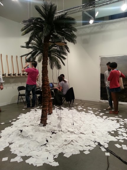 "This palm tree spitting out real-time Google search results for ""United States"" and ""Cuba,"" and ""United States"" and Puerto Rico"" is called Isla. By Peruvian artist Jose Carlos Martinat"