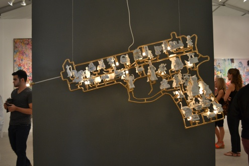 Gold gun made of porcelain figurines