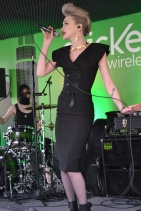 Queen of swamp hop, Ivy Levan, featuring gold gator earrings & necklace