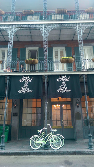 I had to stop and snap a shot of these vintage mint-green bikes resting in front of a typical French Quarter hotel