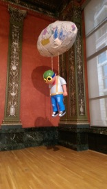 hebru brantley parade day rain art exhibit chicago cultural center flyboy hanging sculpture