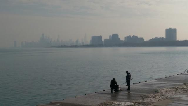 chicago downtown lake michigan skyline fishermen fog